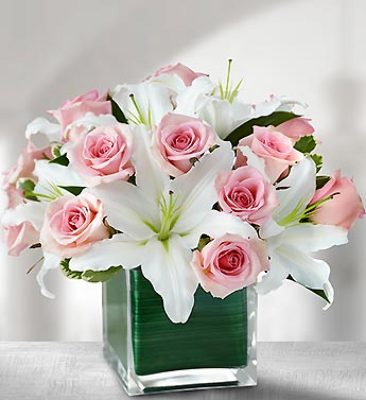 Lilies and pink roses